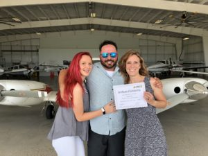 Brad Branum with his wife and daughter at Coastal Skies Hangar | Stripes to Bars